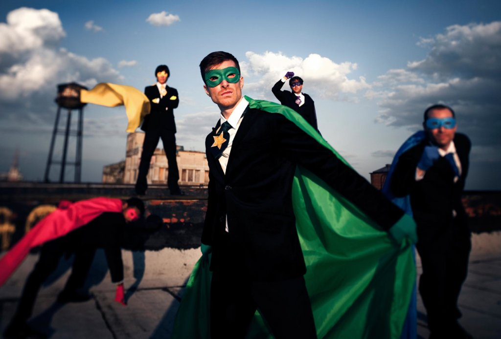 Business men dressed as superheroes